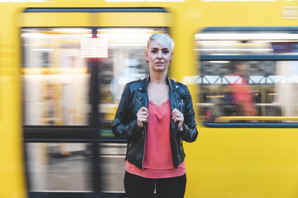 portrait of woman standing at platform