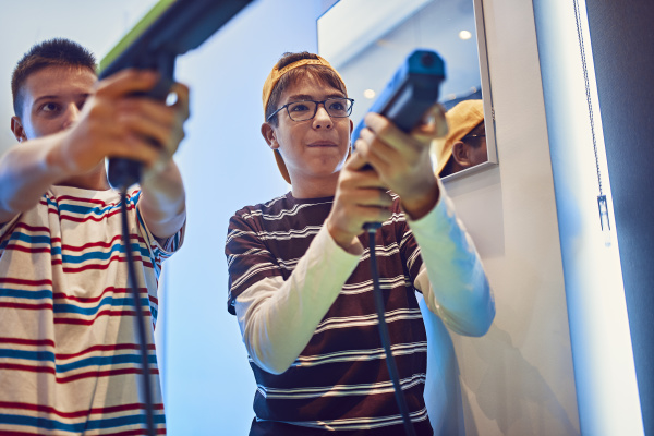 teenage friends shooting with pistols in