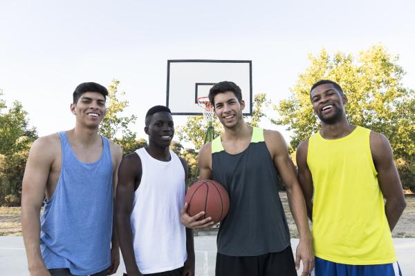 group of multiracial men in sportswear