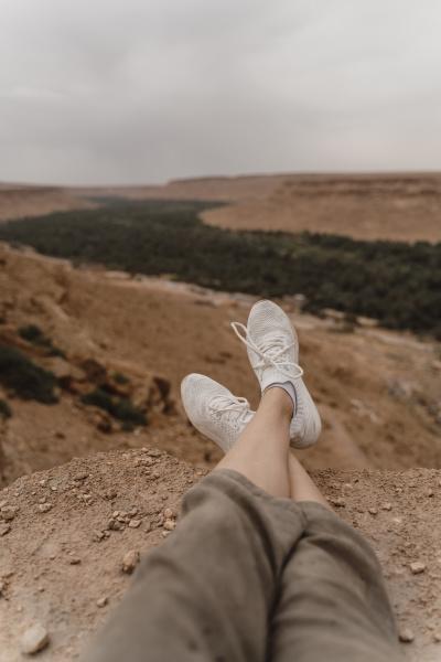 feet of woman enjoying landscape fez