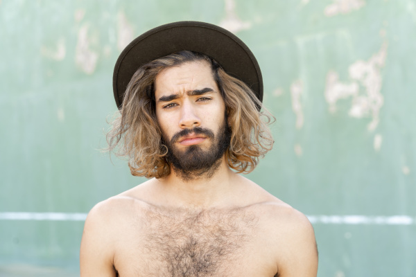 portrait of shirtless young man wearing
