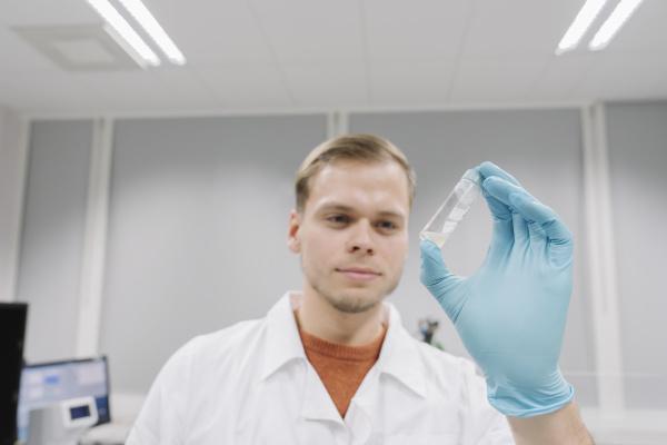 portrait of a scientist analyzing a