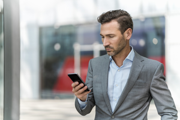 businessman using cell phone in the
