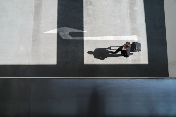 top view of businessman with baggage