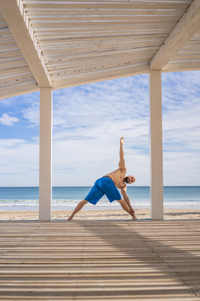 sportsman training at the beach
