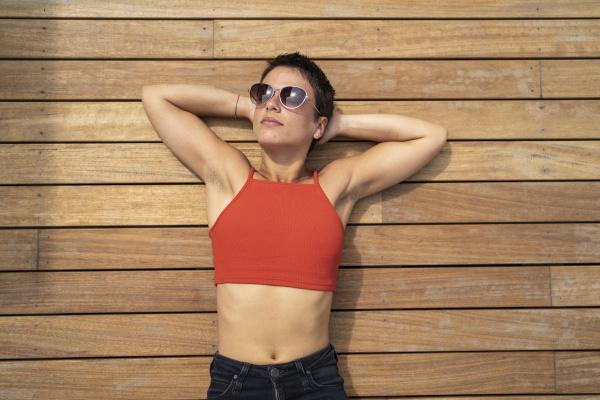 portrait of woman wearing sunglasses lying