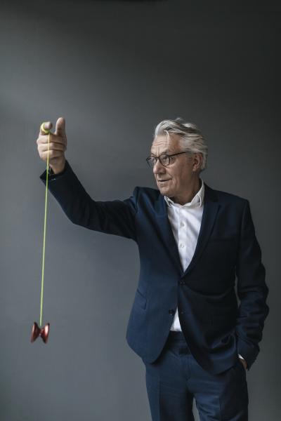 senior businessman playing with yoyo