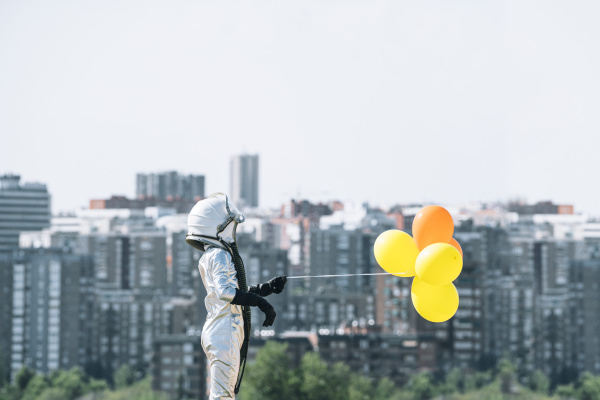 boy dressed as an astronaut holding