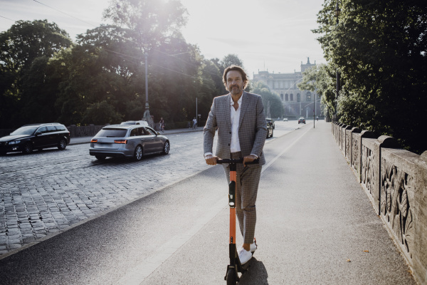businessman with e scooter in the