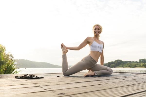 happy young woman doing gymnastics on