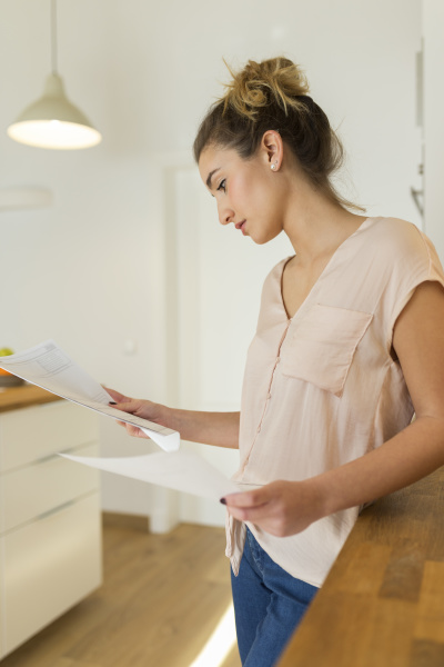 female teenager looking at documents