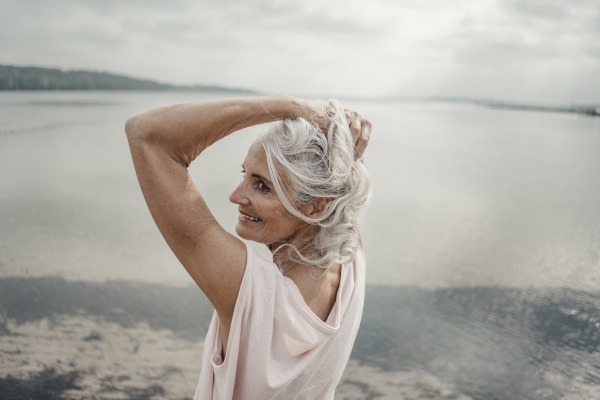 white haired senior woman posing by
