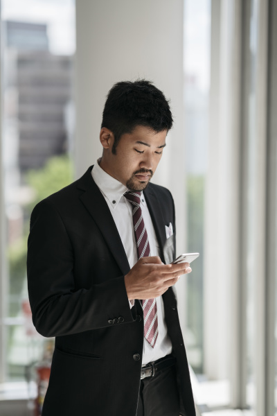 young businessman using cell phone