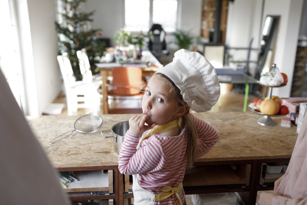 girl wearing chefs hat in the