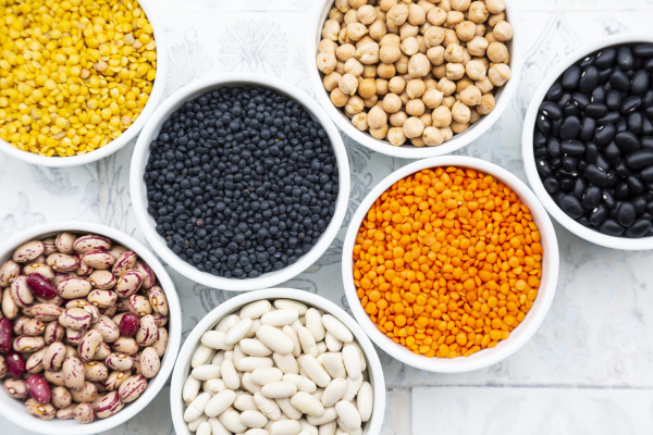 various legumes in bowls chickpeas cannellini