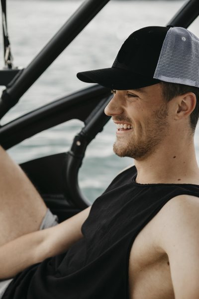happy young man on a boat