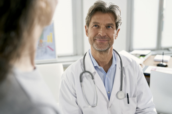 doctor with female patient in his