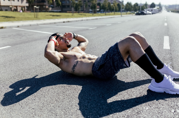 young man doing sit ups on