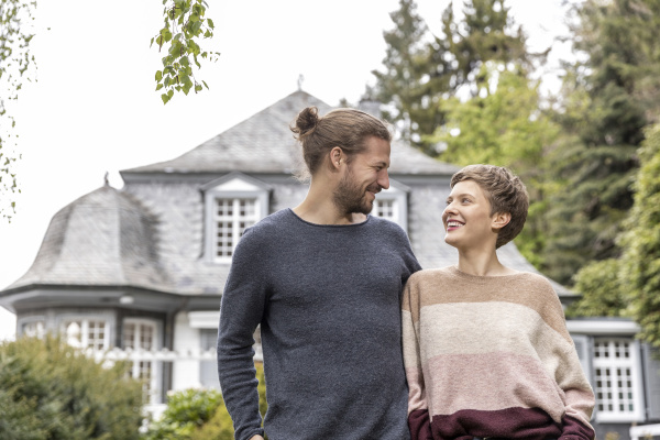 smiling young couple in garden of