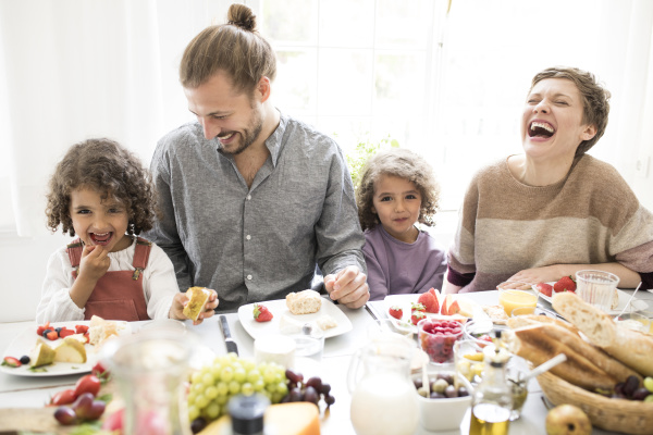 happy family having lunch at home