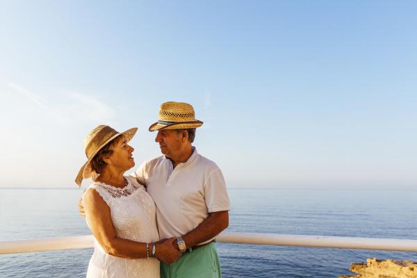 senior couple embracing at viewpoint at