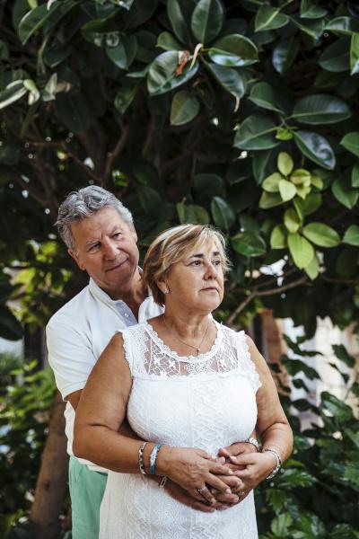senior couple embracing outdoors