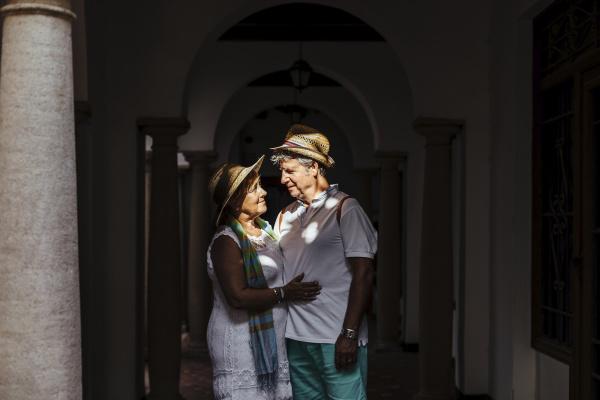 senior tourist couple at a colonnade