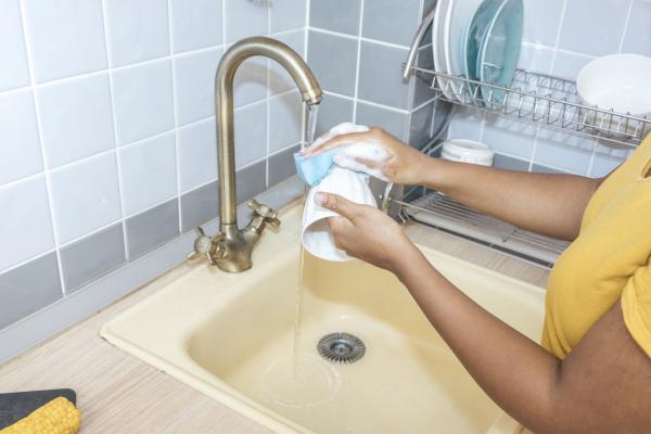 close up of woman washing a