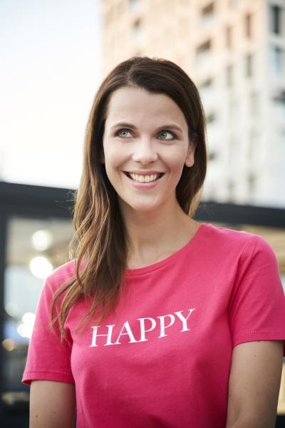 portrait of happy woman wearing pink