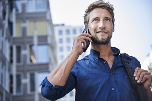 confident young businessman on the phone