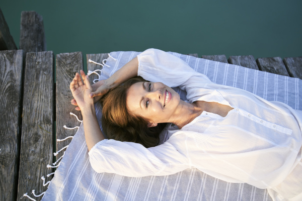 portait of smiling mature woman lying