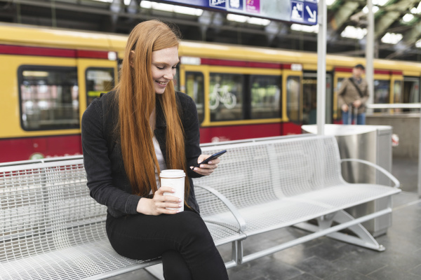redheaded young woman with coffee to
