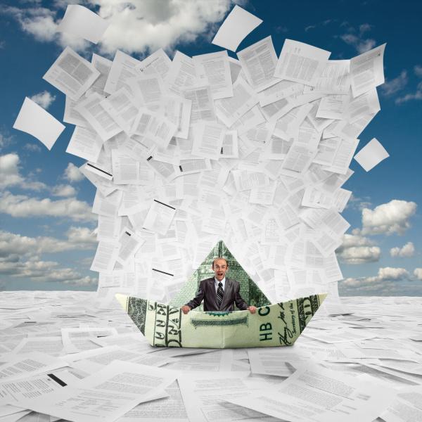 businessman in money boat under wave