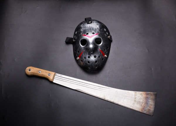 murderer hockey mask and machete isolated