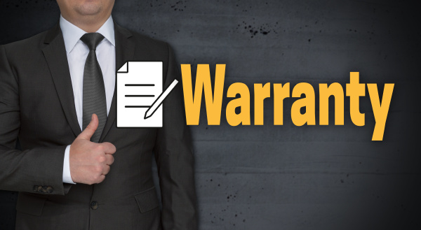 warranty concept and businessman with thumbs