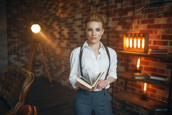 business woman in strict clothes poses