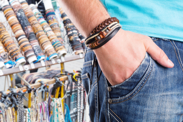 male with leather bracelet