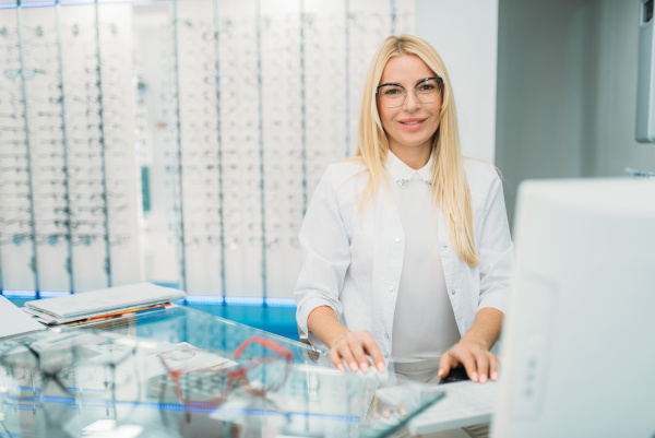 female optician sitting at table in