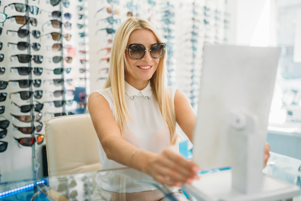 female customer in sunglasses looks at