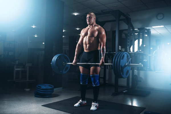 strong athlete exercise with weight in