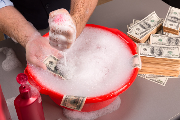 hands are washing dollars banknotes in