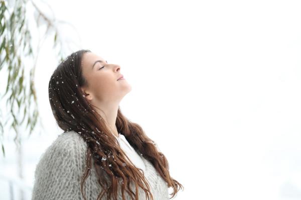 relaxed girl breathing fresh air under