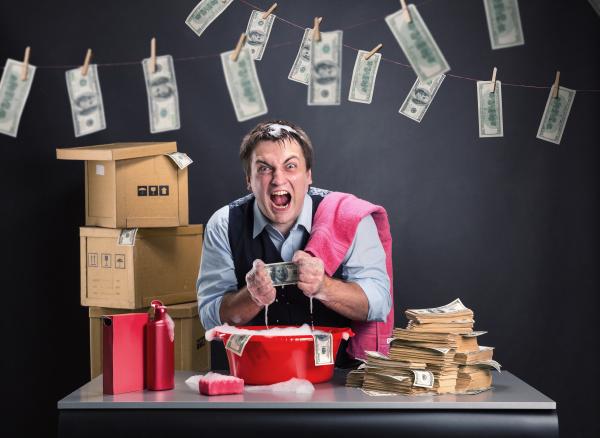 businessman, is, laundering, money - 28065224