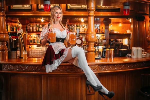 sexy waitress in retro uniform holds