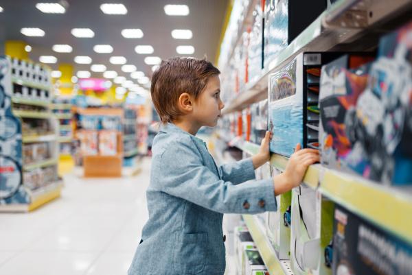 little boy at the shelf in