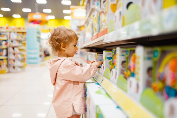 little girl choosing toys in kids