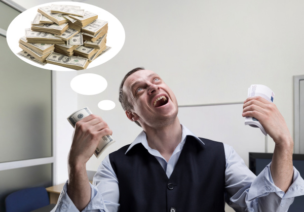 cheerful businessman dreams about money
