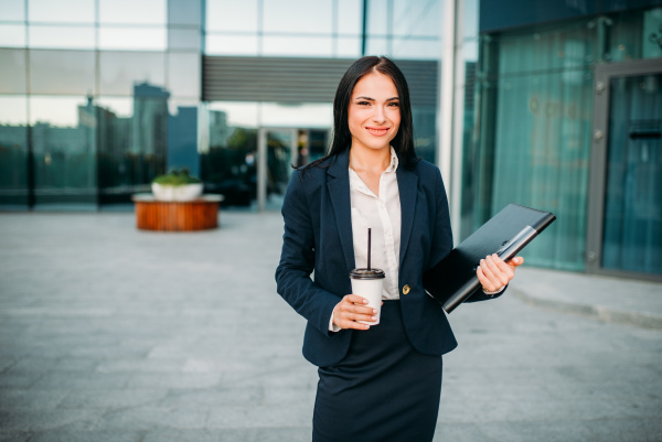 successful business woman with notebook and