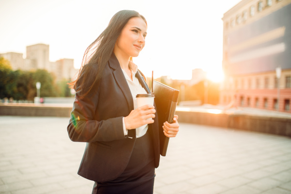 business woman in suit with notebook