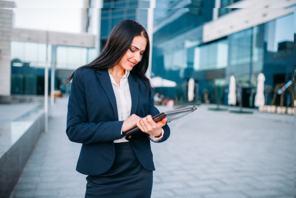 business woman with laptop outdoor